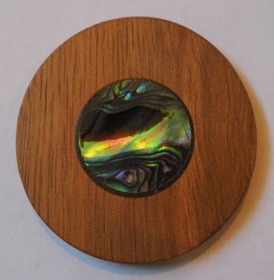 The robinia disc  with the paua centre.