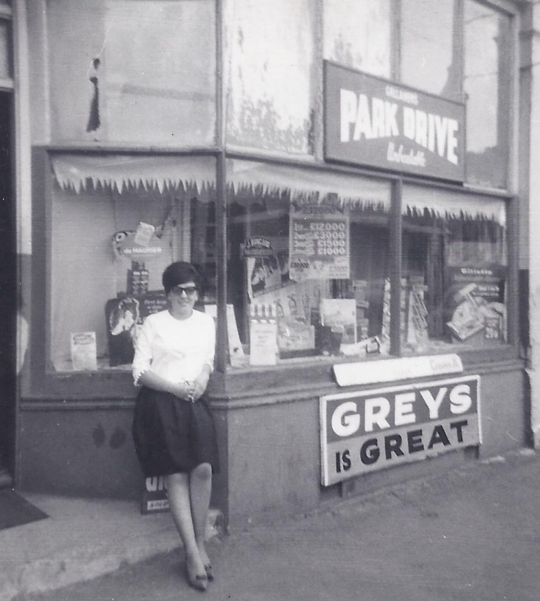 Carol, aged about 16 outside her dad's shop.
