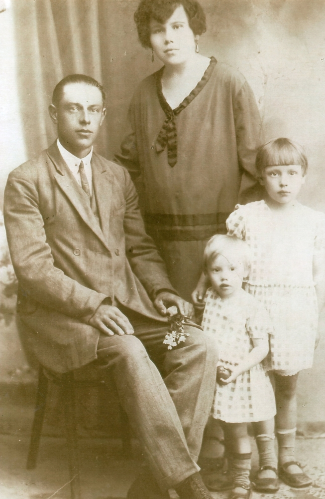 A studio     photograph of Henryk, sitting, and Waleria and their daughters, standing