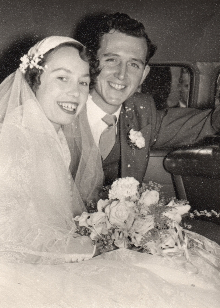 Henia and  George in the wedding car