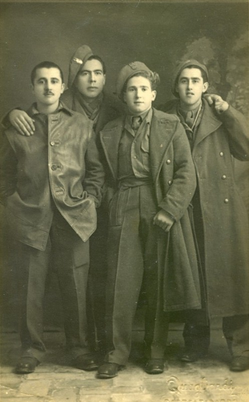 Studio  photograph of Bronisław Bojanowski with three Polish soldiers, standing, relaxed.