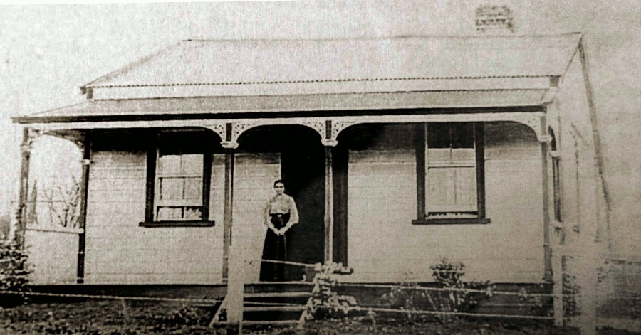 House on  Humphries Street with Anna standing on the porch