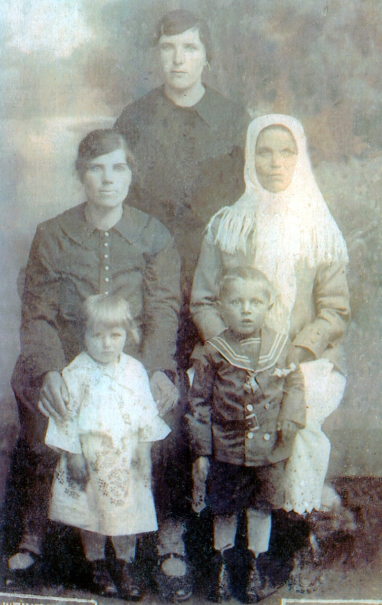 Karolina with her  mother and sister, and Helena and Bronek. A blurry image, all serious