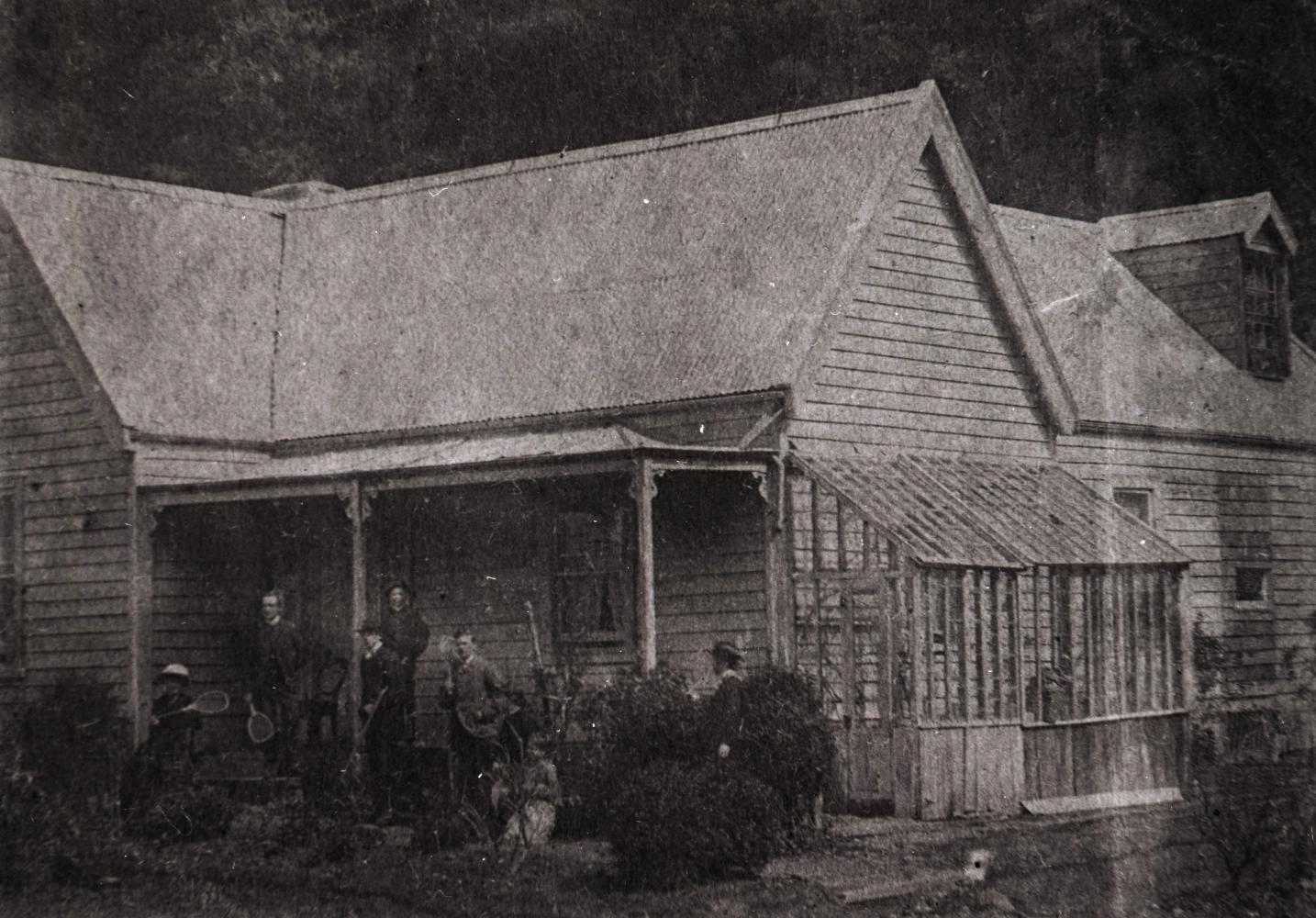 Macfarlane family  group on the veranda of the house above