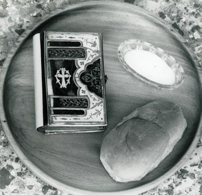 Wooden tray with the  Taranaki bible, salt and bread