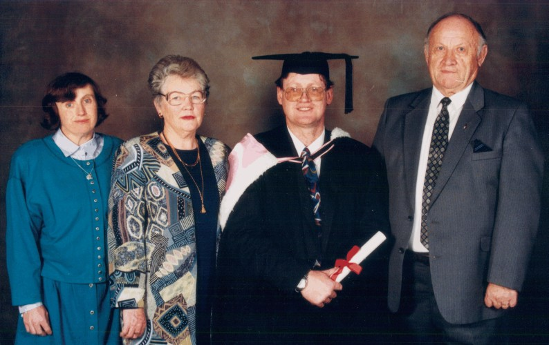 Studio  photograph of Michael's graduation with Jan, Stella and Rozalia 1996.