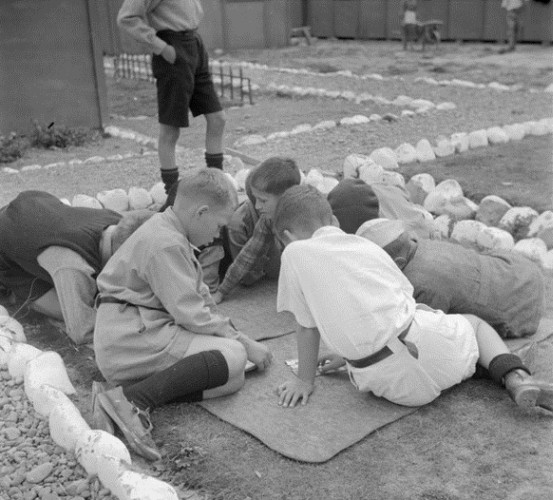 Polish boys  playing a floor game outside