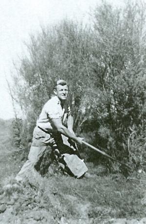 Joe with an axe  scrub-cutting.
