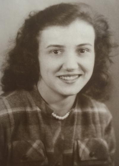 Head and  shoulders shot of Joanna Adamek in England in her early 20s.