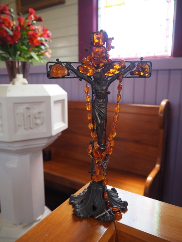 A church crucifix with the  Polish amber rosary beads