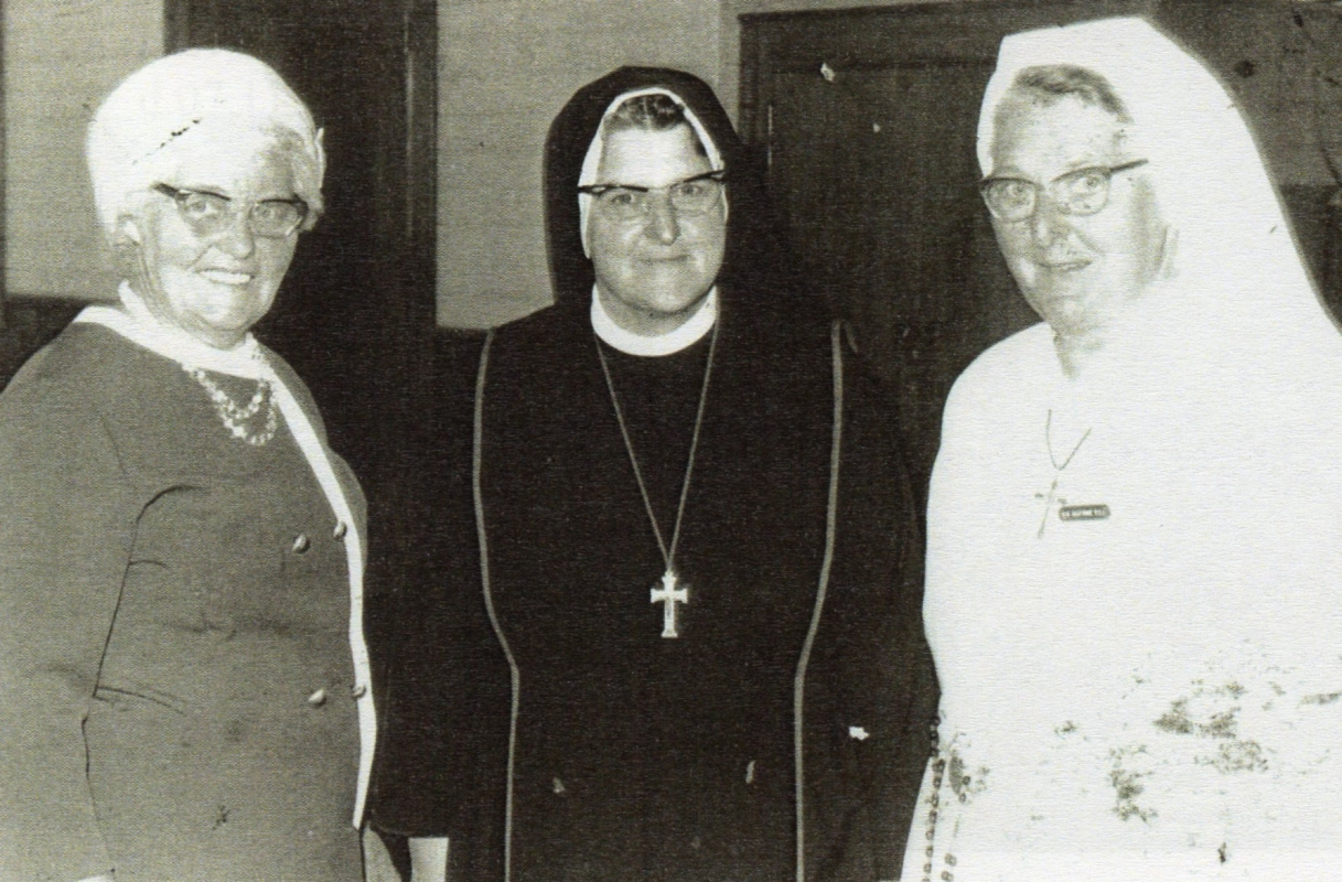 Therese  flanked by her cousins
