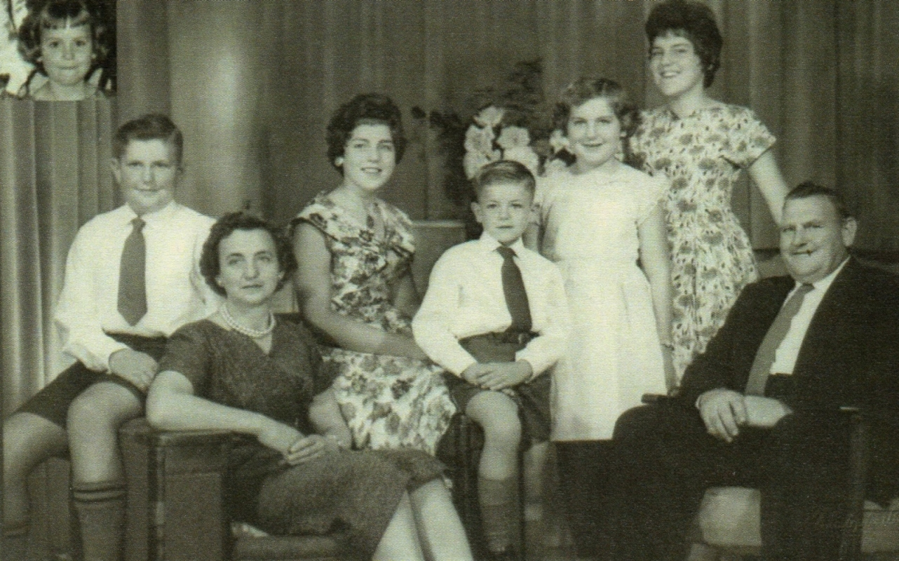 A blurry studio  photo of Clement and Anne Kuklinski and their six children.