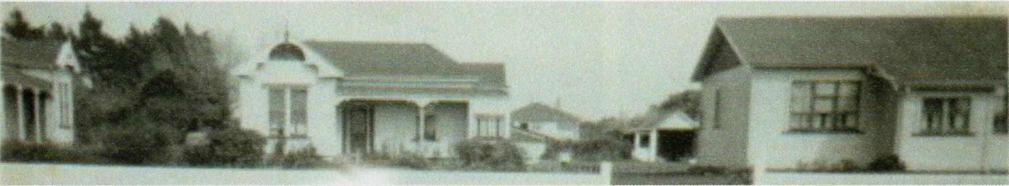 A narrow shot of  the three houses