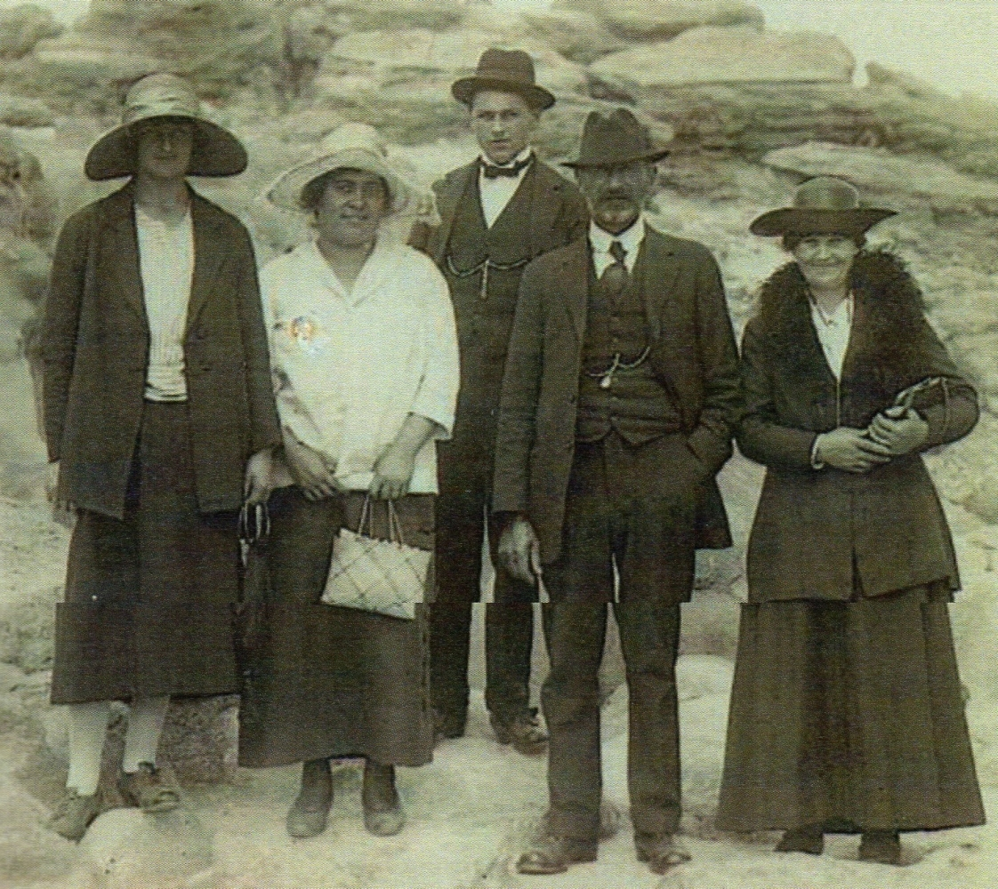 Mary and August  Uhlenberg with two adult children and a woman guide in front of a rocy outcrop.