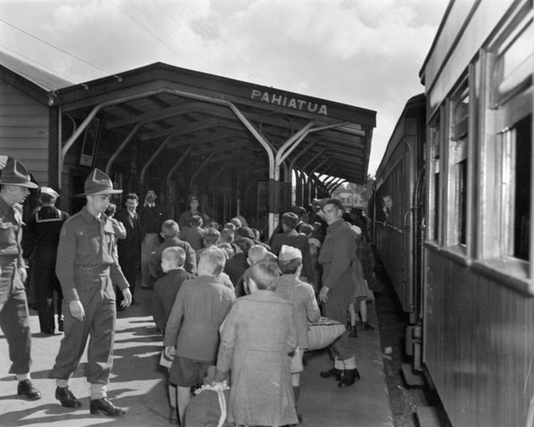 Backs  of Polish boys with NZ soldiers at Pahiatua Railway Station