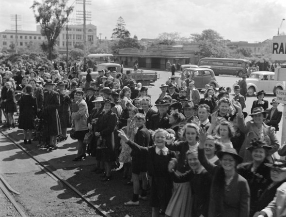 Another  crowd in Palmerston North waving to the train