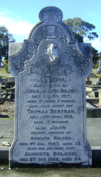 Headstone  of John and Augusta Boloski, and their sons John and Joseph Thomas