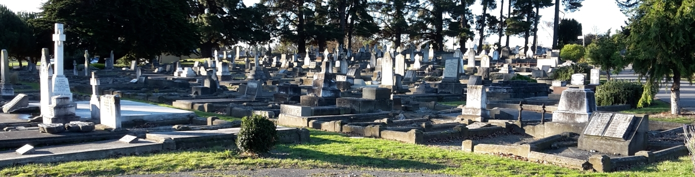 Wide view of  the Linwood cemetery, showing headstones in the setting sun.
