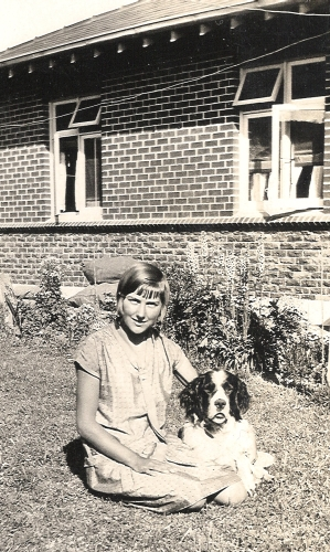 Gertrude Orlowski sitting with the dog in the back garden