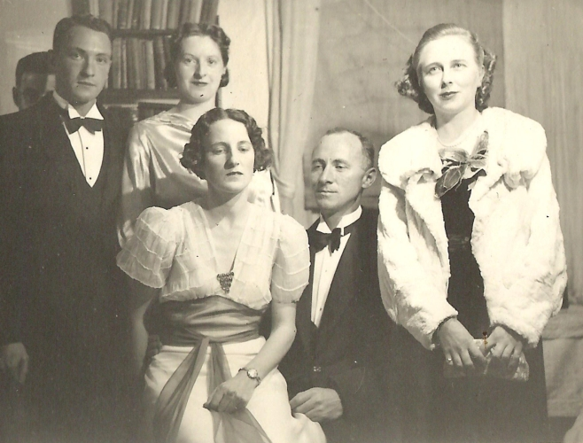 Madeline,  right, with friends in evening attire