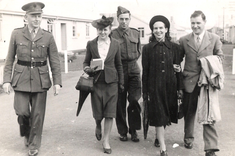 Madeline, centre, with Rayena and her husband in Auckland, and two men in army uniform