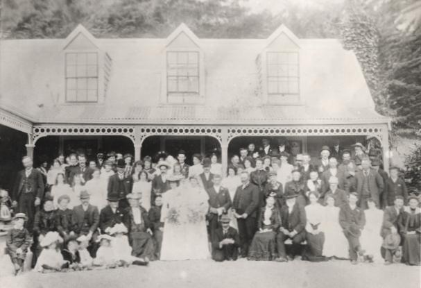 The Orlowski-Robinson wedding group outside the Robinson homestead