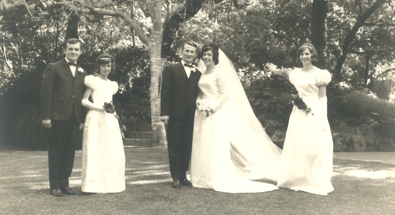 Victor and Elaine on their     wedding day with their two bridesmaids and best man at the Wellington Botanic Gardens