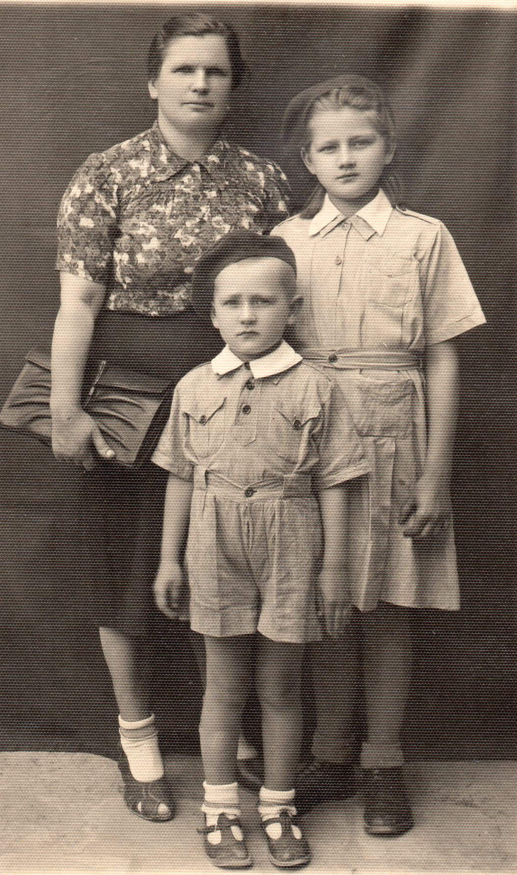 A studio pic of  Mrs Budzyń with Zofia and Victor.