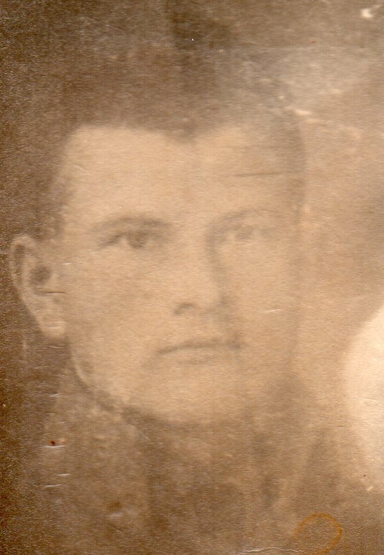 Head shot sepia  pic of Wojciech Pleciak in army uniform