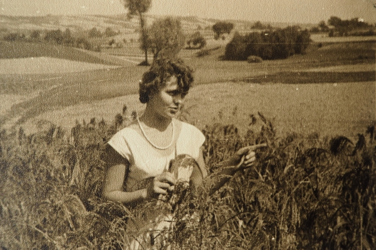 Eleonora Wojtyga  as a young woman in a field at her parents' farm