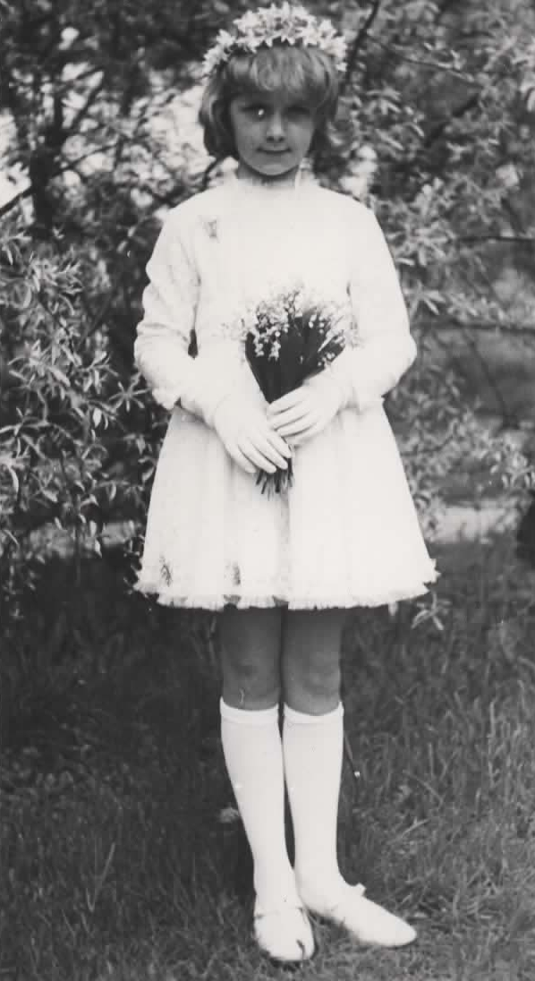 Małgosia after her First Holy Communion