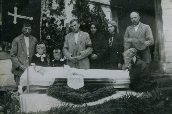 Rozalia Jarka in an  open coffin with her family looking on