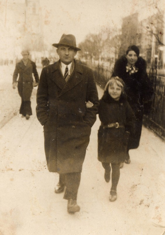 Stanisław Jarka  striding along a street in Białystok with his daughter, Jadzia.