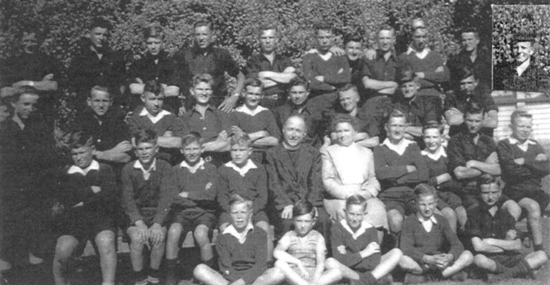Group photograph of  Hawera pupils with probably Mr and Mrs Tietze and a priest.