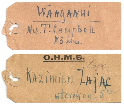 two sides of an  old-fashioned railway tag, on one side written WANGANUI Mrs T Campbell, N 3 Line and the other, printed with OHMS and  Kazimierz Zając, wtorek o g 5.20, or Tuesday at 5.20