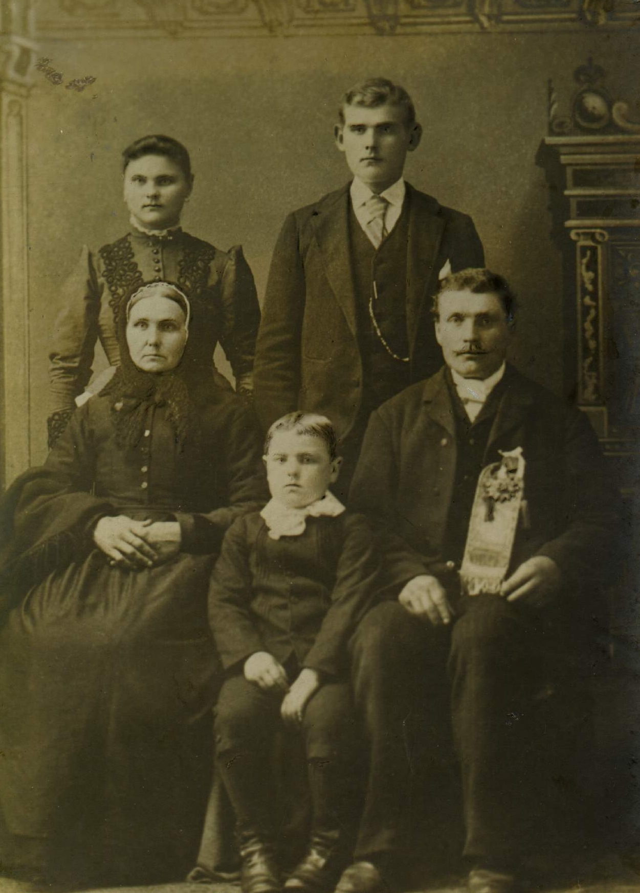 A studio photograph of Johann and Francizka,  seated with Michael as a young boy between them and Mary and Joseph standing behind them.