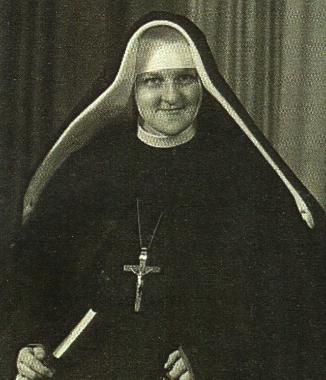 Therese smiles gently at  the camera on the occasion of professing her vows.