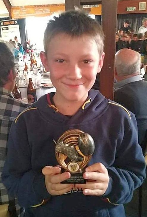 Thomas Kreft smiling  with his Most Improved Player award