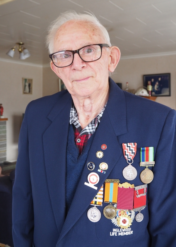 2019 photograph of  Joe, wearing his Inglewood Fire Service Life Member jacket, with his six fire-service medals and numerous lapel pins.
