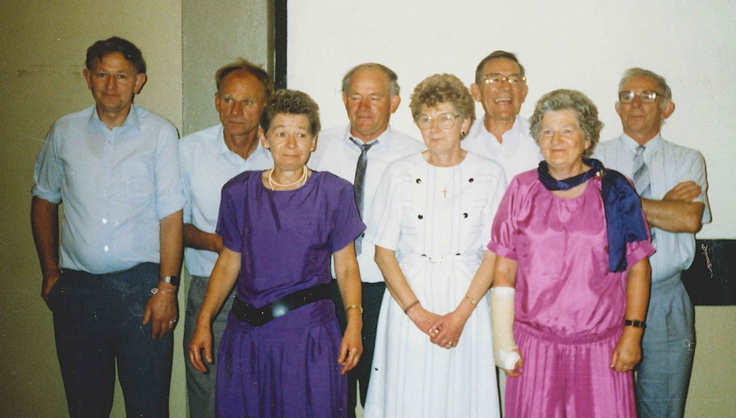 Coloured informal  photograph of the Kuklinski. The sisters are dressed in their wedding finery, the brothers less formal, in shirts but only  Tom and Joe still with their ties.