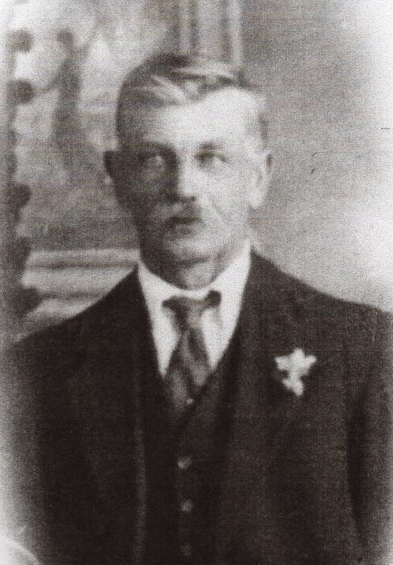 An upper body studio  photograph of Bernard in a suit