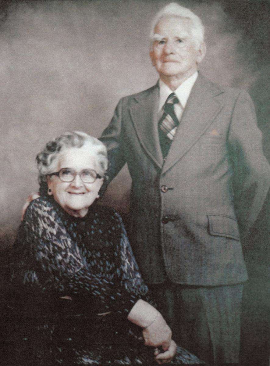 Studio  photograph of Thomas, standing, and Nancy, sitting