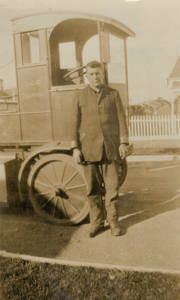 Bert Luskie next to his    tram