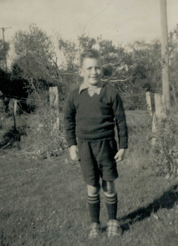 Kenneth Luskie as a boy  in the farm garden