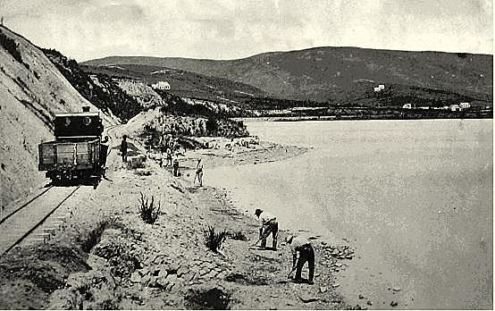 Men working at  the side of Waihola Lake