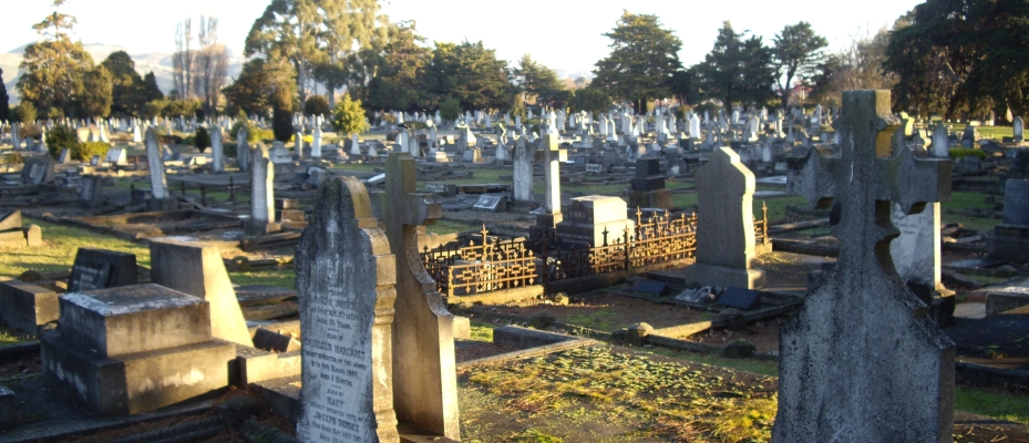 Another wide view of  the Linwood cemetery, showing headstones in the setting sun.