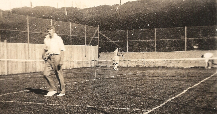 John Lovelock in the foreground of the Orlowski tennis court