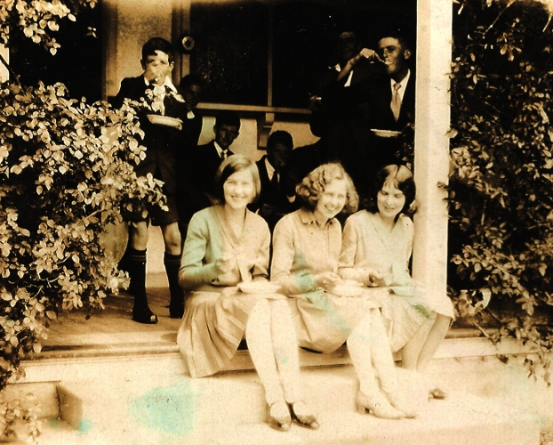 Gertrude, Madeline and Rayena Orlowski sitting on the steps of a friend's house