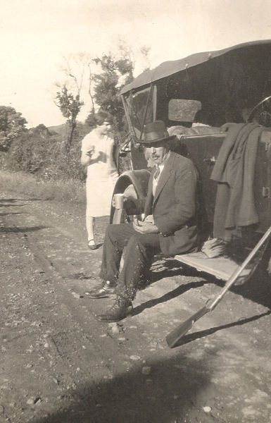 John Andrew  Orlowski sitting on the running board of his Crossley