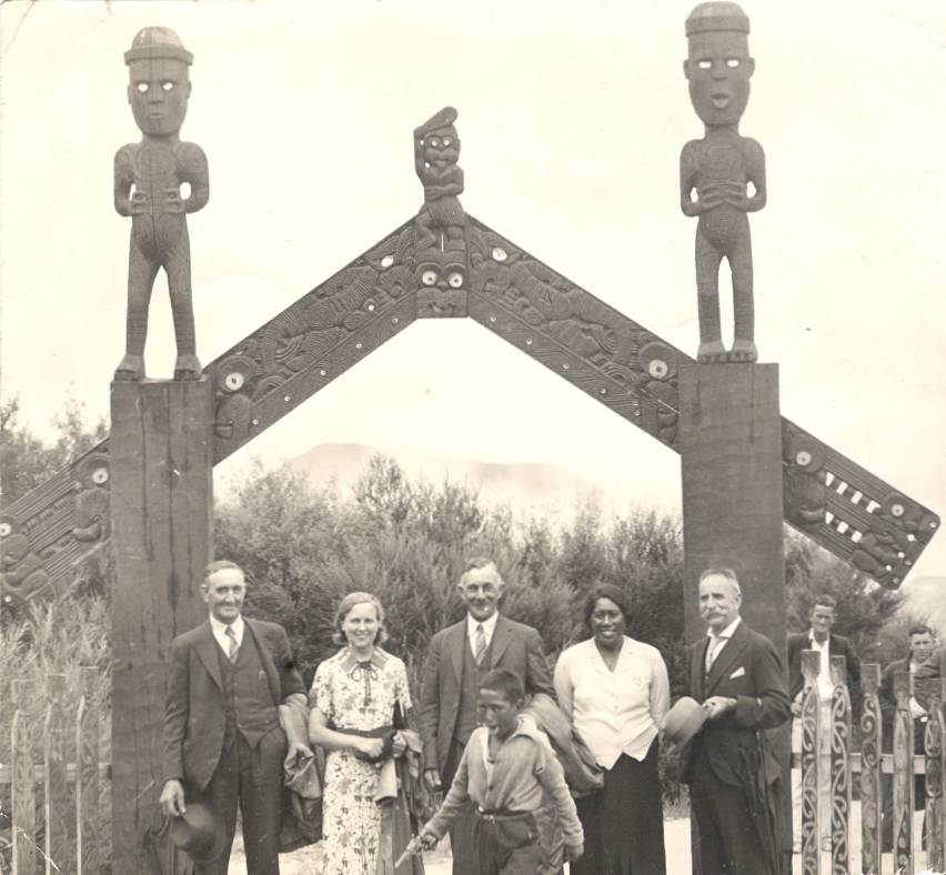 John Andrew and Madeline with others in front of Maori arch
